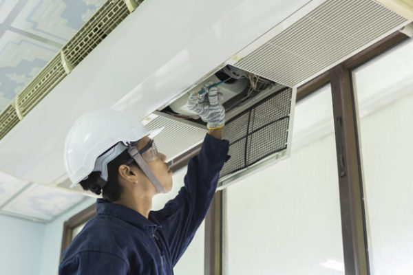Air Conditioner Cleaning Man Gloves Checks Filter Young Man Adjusting Air Conditioning System 39733 466