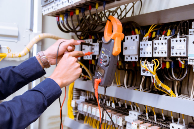 Electrician Testing Electric Current Control Panel 34936 2970