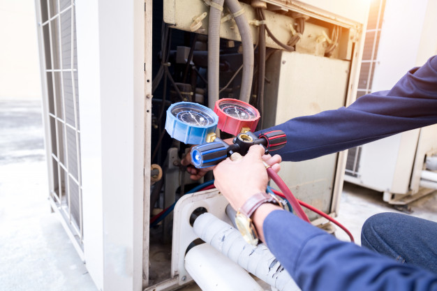 Technician Is Checking Air Conditioner Measuring Equipment Filling Air Conditioners 34936 2759
